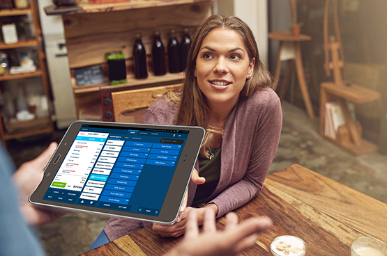 Server taking a tableside order on Duet POS System